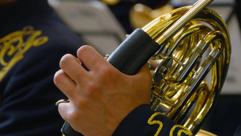 Musician playing the French horn, closeup Footage