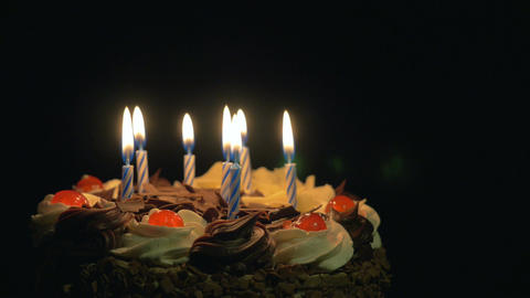 4k - Blowing out birthday candles on delicious chocolate cake Footage