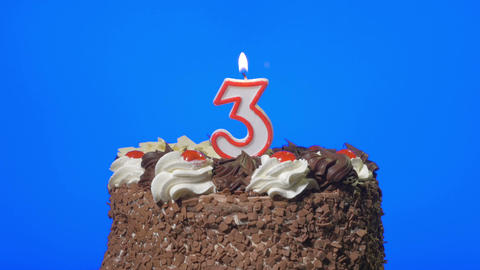 4k - Blowing out number three birthday candle on a delicious chocolate cake, blu Footage