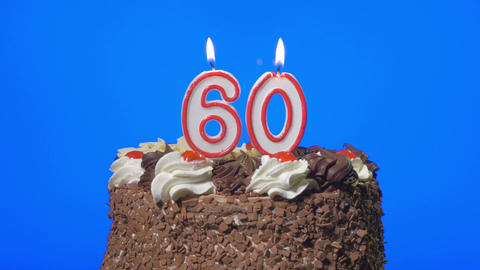 4k - Blowing out number sixty birthday candle on a delicious chocolate cake, blu Footage