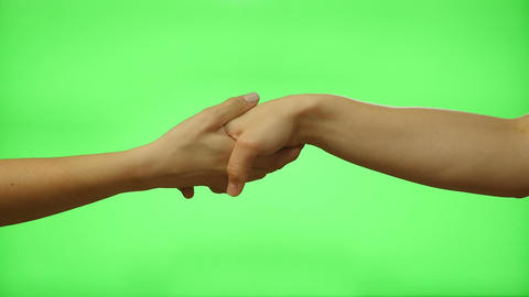 Female hand shake on a green screen Footage