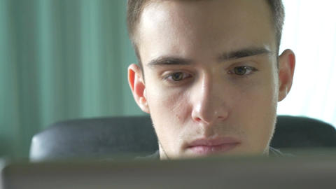 4k UHD - Young man browsing on a tablet pc Footage