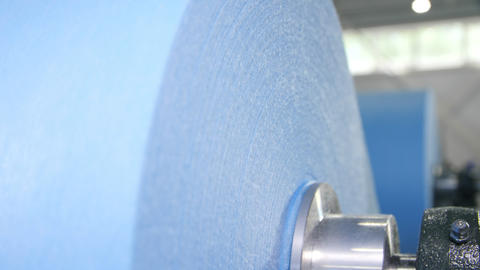 huge roll of light blue textile material for medical masks Live Action