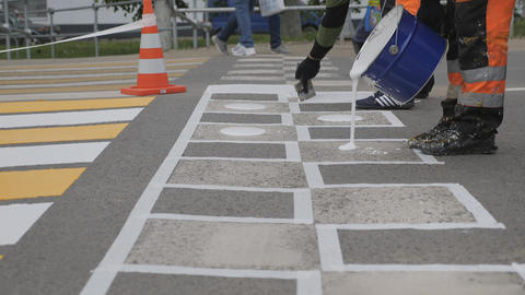 Road markings. Applying paint to a speed bump Live Action