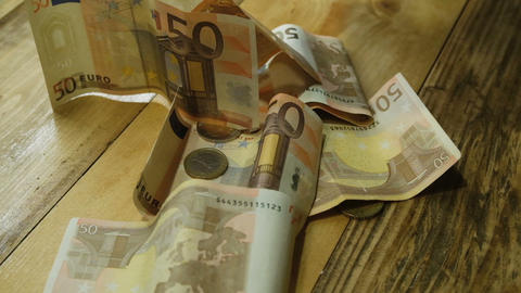 Euro bills bancknotes falling on a table,drop money slow motion,economy business Live Action