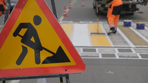 Road markings. Road sign road works on a yellow background Live Action