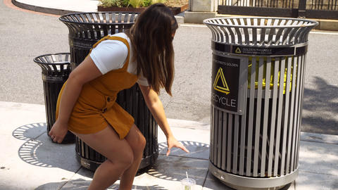 4K Young Millennial Asian Woman Picking Up Trash and Recycling Live Action