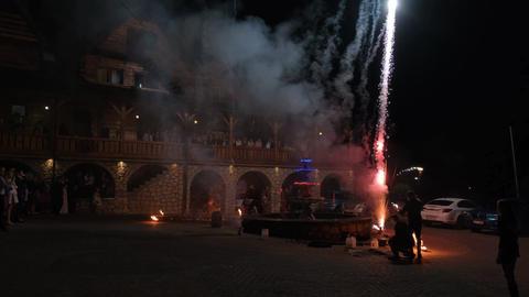 Shooting fireworks at night. People are watching fireworks Acción en vivo