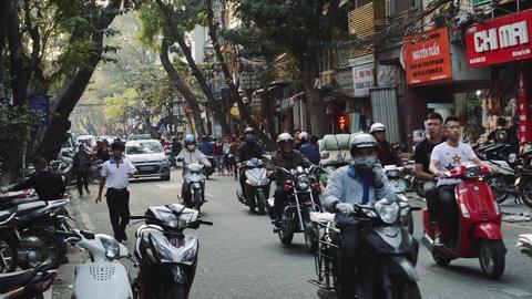 The Bustling Street Scene Of Hanoi, Vietnam, Old Town, Motorcycles Cars Traffic Acción en vivo