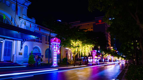 A night timelapse of neon town at Nguyen Hue street in Ho Chi Minh wide shot Acción en vivo
