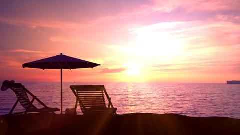 Empty deck chairs and beach umbrella on empty ocean beach Animation