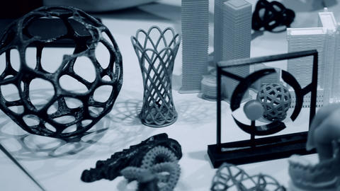 Colorful objects printed by 3d printer. Fused deposition modeling Live Action