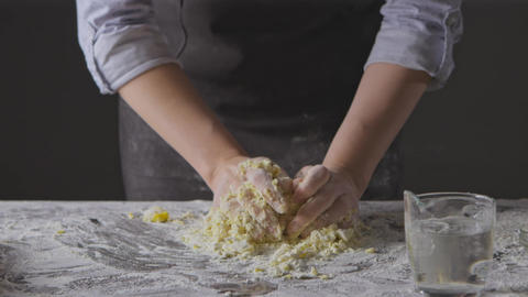 Step by step process of preparation homemade dough. Chef woman's hands knead Live Action