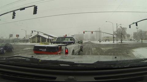 Winter storm urban salt truck at traffic light POV HD 0215 Footage