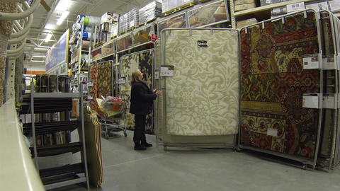 Woman shopping for rugs for home department store HD 018 Footage