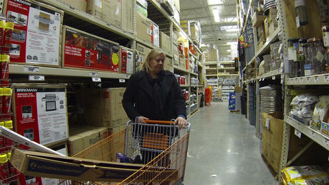 Woman shops in hardware store HD 014 Footage