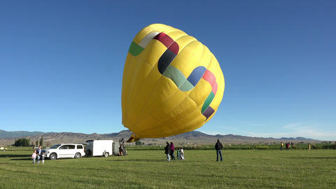 Yellow hot air balloon ready for flight 4K Footage