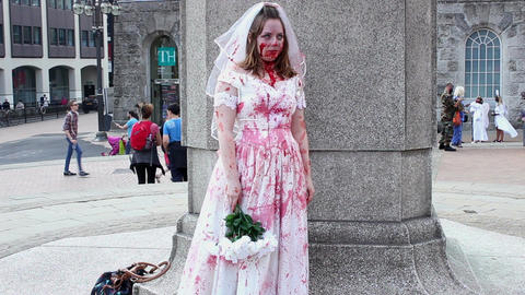 Bloodied zombie bride getting confused - scary Footage