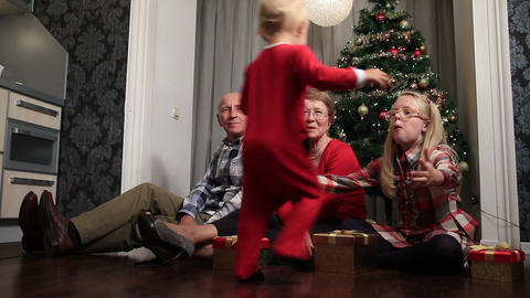 Toddler boy in christmas outfit embracing sister Footage