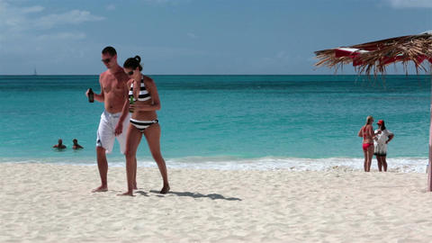 Young attractive couple on Caribbean beach Antigua Island HD 1240 Footage