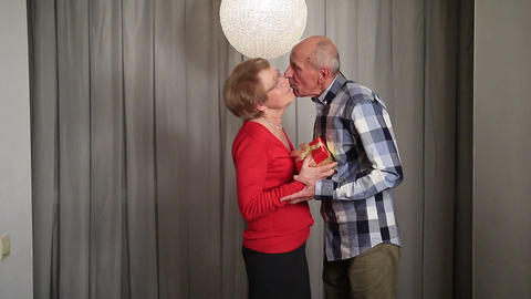 Senior man giving valentine's gift to his wife Footage