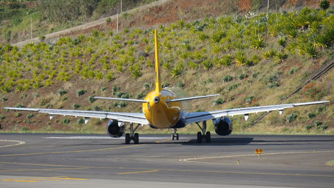 Madeira Airport. An Airliner Airbus A321 G-OZBH by Monarch Taxi 4K Live Action