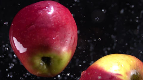 Explosion of apples with water. Slow motion 250 fps Live Action