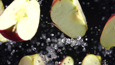 Explosion of apples with water. Slow motion 500 fps Live Action