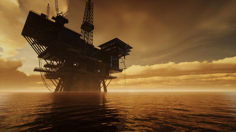 Offshore Jack Up Rig in The Middle of The Sea at Sunset Time Live Action