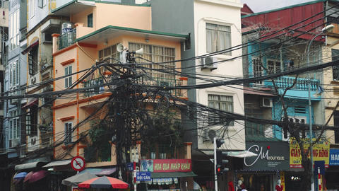 Power lines electric cables in the city streets of Hanoi, Vietnam Live Action