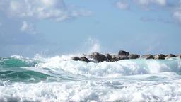 Waves splashing by wavebreaker, real time Live Action