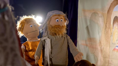 Puppet theater playing Bible story Live Action