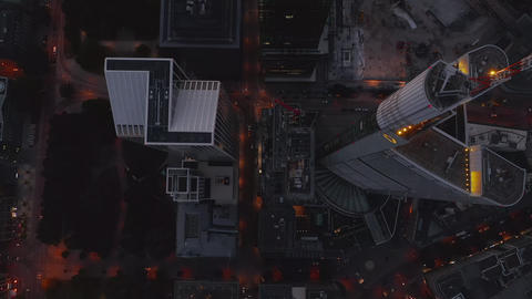 AERIAL: Beautiful rise up Shot between huge Skyscrapers in European City Live Action