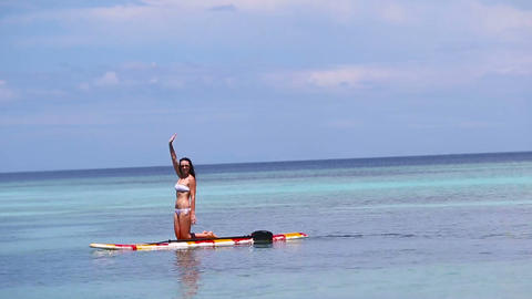 Attractive Young Woman Stand Up Paddle Surfing, Beautiful Tropical Ocean Live Action