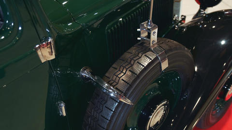 Spare wheel of green vintage car Live Action