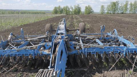 Disking the soil. Short disc harrow Live Action