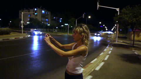 Girl in the evening makes the video on your smartphone Footage