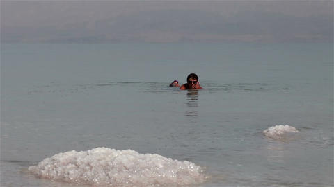 Dead Sea. Woman bathing Footage