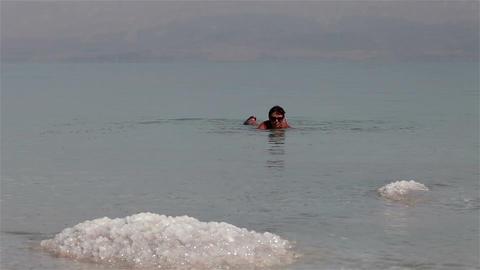Dead Sea. Woman bathing Footage