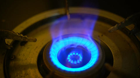 Hand lighting gas burner slow motion Footage