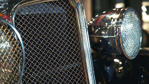 Close-up of shiny chrome radiator grill of old vehicle Live Action