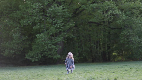A little blond girl running in slow motion in grey, slow motion Live Action