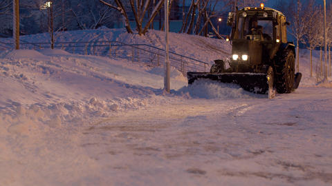 Snowplow cleaning the road in evening ライブ動画