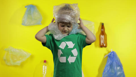 Girl activist free up from plastic packages on her neck and head. Plastic Live Action