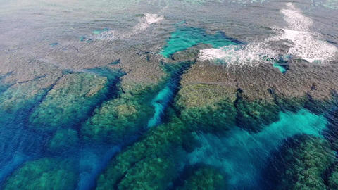 Drone aerial view of the beautiful blue sea, rich in coral reefs of Ishigaki Island, turning and Live Action