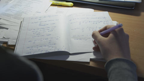 The man solves mathematical problems in a notebook and prepares for training Live Action