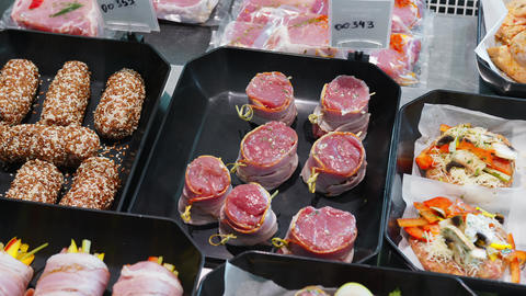 Close Up Appetizing meat products are on display in special containers. Meat Live Action