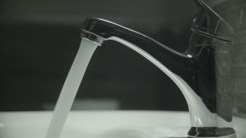 Water pours from the tap, high pressure ライブ動画