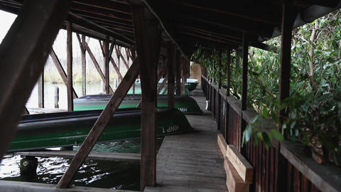 A few old shabby and worn boats different colors on the dock ライブ動画