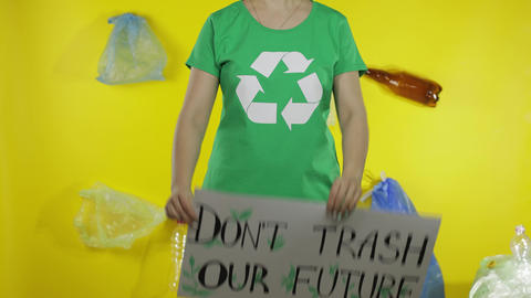 Unrecognizable woman holding protesting poster Don't Trash Our Future Live Action